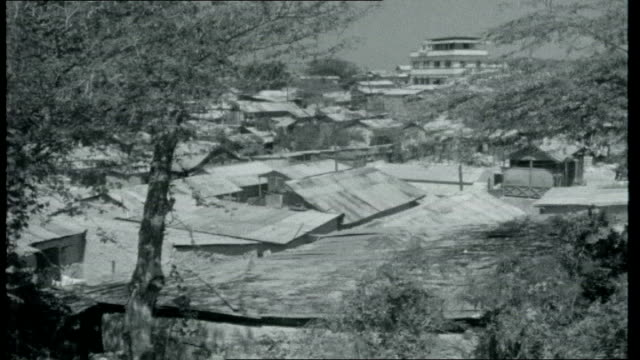 castro's neighbour haiti haiti portauprince ext part of coastline top view of town different style buildings including french colonial townhouses... - イスパニョーラ点の映像素材/bロール