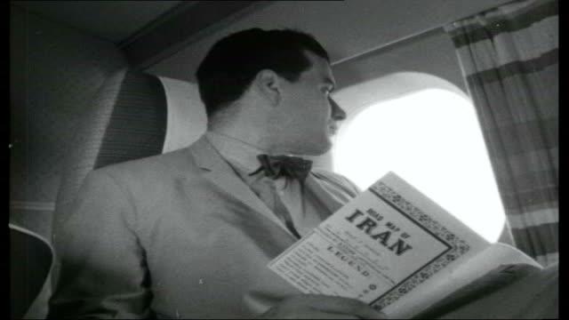 vidéos et rushes de caviar in the caspian iran tehran ext * * music overlay sot * * plane taxiing along tarmac itn reporter reading book about iran ext plane steps... - iran