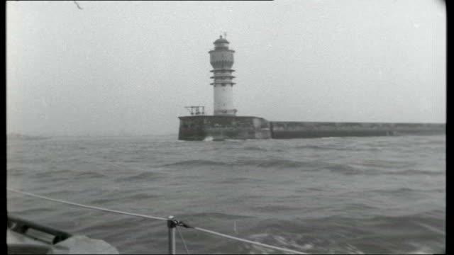 stockvideo's en b-roll-footage met channel cruise rough seas seen through boat's window / reporter sleeping in bunk / captain speaking into radio / cee jay sailing in calmer seas /... - hijsen