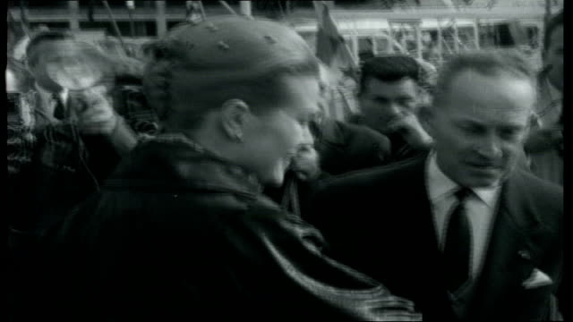cloud over monaco car stopping by photographers princess grace out of car and greets duke of westminster as press take picutres tourists on wall... - monaco stock-videos und b-roll-filmmaterial