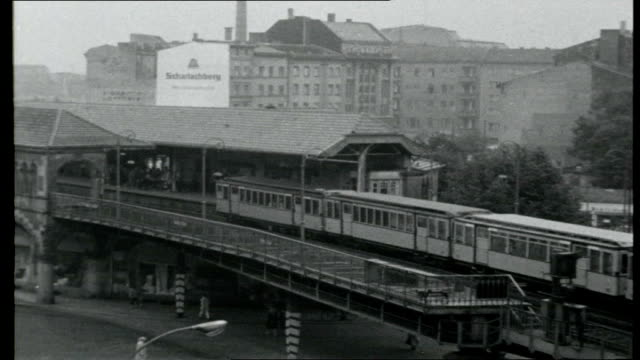 crisis in berlin east berlin guards erecting barbed wire border fence/ closedoff potsdamer platz train station entrance/ raised railway train stops... - bridge built structure stock videos and b-roll footage