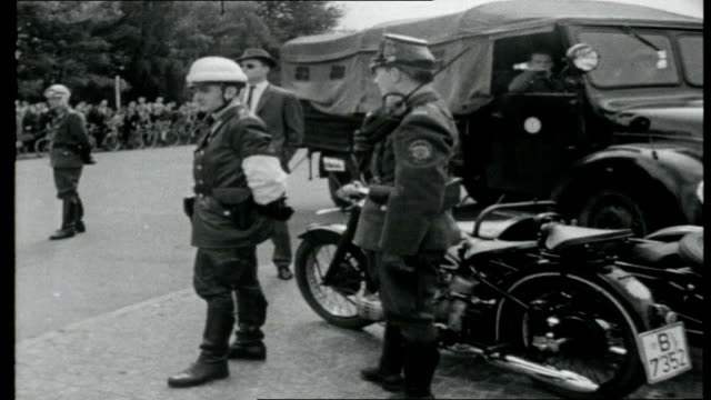 crisis in berlin; east german troops and police guarding brandenburg gate/ east german soldiers laying concrete blocks and barbed wire across roads... - guarding stock videos & royalty-free footage