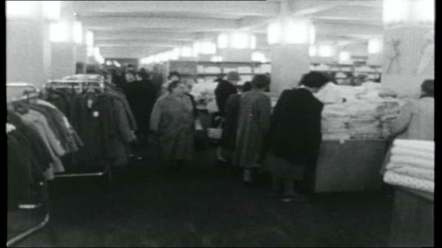 east germany now weimar long line of housewives queuing up to buy cabbages at market stall / general views of shoppers along in high street shop... - weimar video stock e b–roll