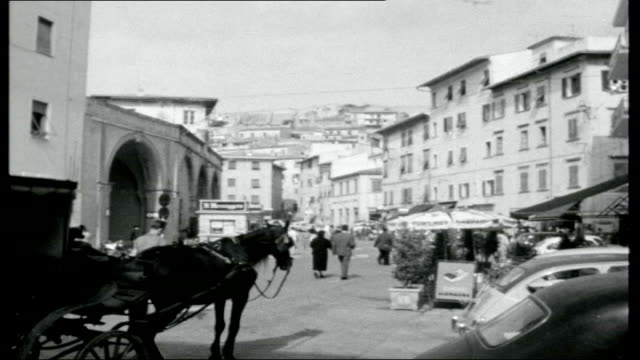 elba island of napoleon view of sea and coastline from ferry reporter to camera tourist cars driving off ferry as arrive in elba people standing... - marble wall stock videos and b-roll footage