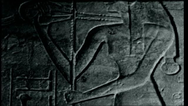 vídeos y material grabado en eventos de stock de high dam over abu simbel steamer boat along on nile general views temple of queen nefertari interior of temple with carvings and hieroglyphics on... - jeroglífico