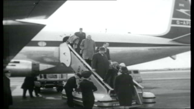jet set england london heathrow airport int airport departures board / air passengers along planes on airport tarmac / comet 4 jet plane taxiing... - captain stock videos and b-roll footage