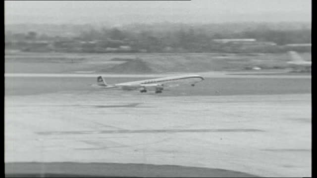 jet set ext heathrow airport control tower air traffic controllers at work / plane taking off ext bill woodruff interview sot on supersonic jet... - serving tray stock videos and b-roll footage