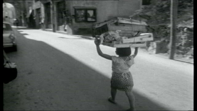 journey through sicily women working in fields / woman along with jar balanced on her head / girl along carrying wooden crates on her head / women... - 1950 1959 stock-videos und b-roll-filmmaterial