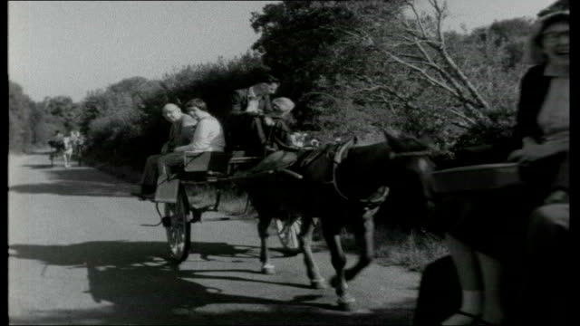 killarney, usa?; shots of tourists outside great southern hotel setting off for tours on horse-drawn side-cars or 'jaunting cars' / various shots of... - sidecar stock videos & royalty-free footage