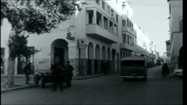 vídeos de stock, filmes e b-roll de libyan journey tripoli reporter disembarking from plane sign 'idris airport' benghazi various street scenes with horses and carts along in street... - líbia