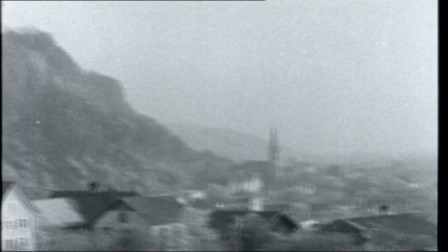 vídeos de stock, filmes e b-roll de liechtenstein liechtenstein vaduz ext reporter to camera as introducing location including general views of royal palace on hill capital vaduz in... - 1950