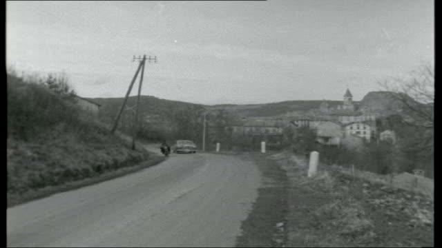 monte carlo rally france int cars driving off ferry cars driving away into the night day tracking shot as along passenger in john cotter's car... - 1950 1959 stock videos & royalty-free footage
