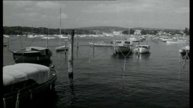 norwegian note book; life anderson interview sot small boats in harbour, norwegians on beach and naked child paddling in water ski slope and student... - signierstunde stock-videos und b-roll-filmmaterial