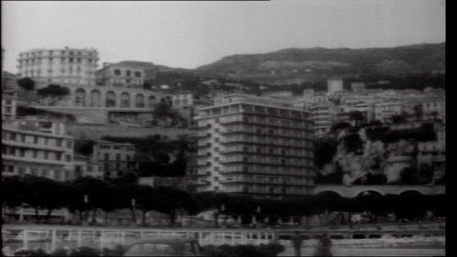 Prince Rainier's Gamble EXT General views of buildings along seafront Business signs on wall Entrance to Hotel Metropole General view of Hotel du...