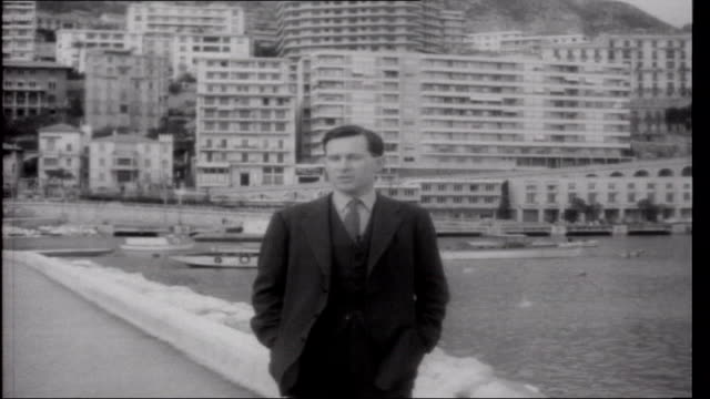 prince rainier's gamble monaco monte carlo ext reporter to camera french customs men checking cars and drivers on charles de gaulle french imposed... - royal palace monaco stock videos and b-roll footage