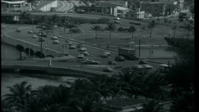puerto rico puente dos hermanos bridge over sea carrying a few cars along and high rise buildings in the background and top view of traffic on... - due oggetti video stock e b–roll