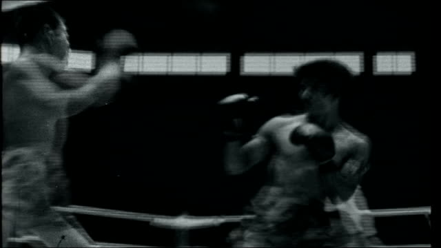 round the world 1 tracking shot along road and past tricycle rickshaws spectators sitting in boxing stadium close up of men sitting kick boxer in... - kick boxing stock videos and b-roll footage