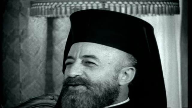 vídeos de stock e filmes b-roll de royal crisis in holland / cyprus nicosia int peter snow interview with greek cypriot president archbishop makarios about troubles sot - peter snow