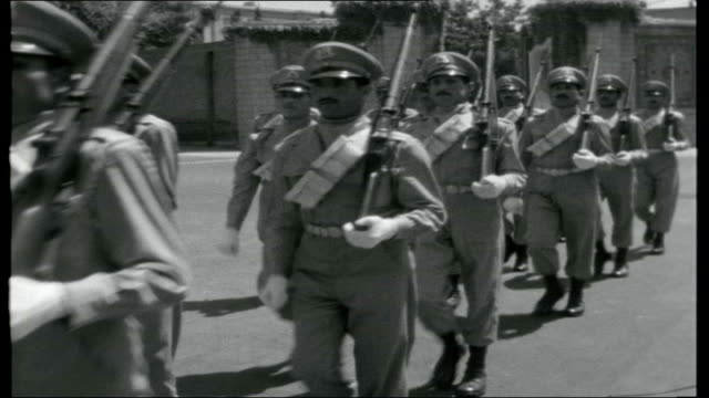 royal persia iran tehran ext * * music overlay * * opening credits over iranian military parade / various of imperial guard marching on parade /... - 1959 stock-videos und b-roll-filmmaterial