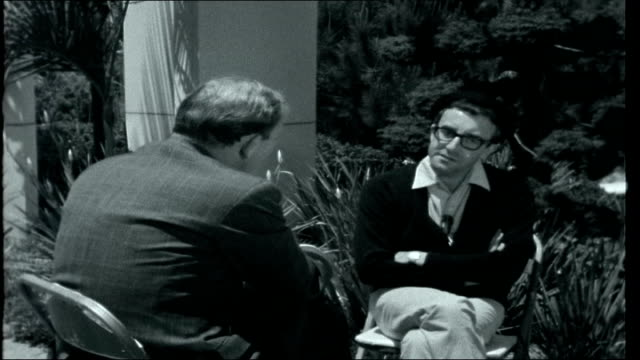 sellers at home / tall ships race usa california hollywood beverly hills ext house of peter sellers reporter and sellers sit in garden for interview... - retail occupation stock videos and b-roll footage
