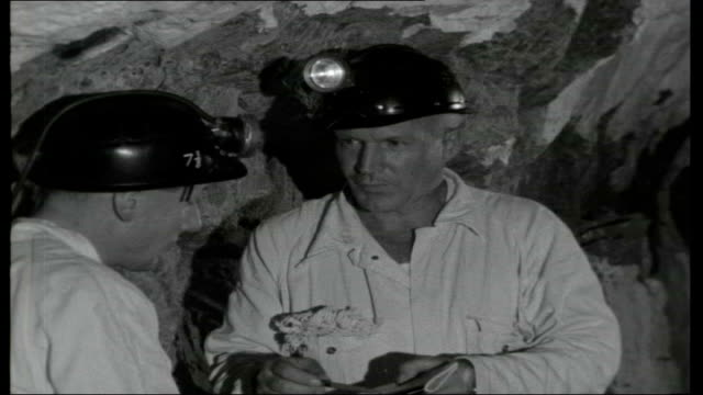 South Africa The Big Deep Reporter towards along mine tunnel nexxt mine supervisor / Interview with mine supervisor SOT / Various of mine workers...