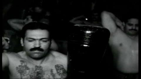 teheran today; iran : tehran : int * * iranian chant and drumming heard during the following shots sot * * opening sequence iranian man drumming,... - musikinstrument bildbanksvideor och videomaterial från bakom kulisserna