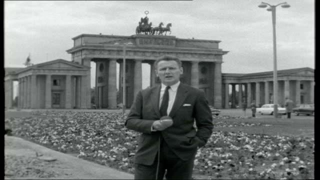 the divided city germany berlin ext east and west berliners along in street titles 'the divided city' east berlin reporter to camera high angle shots... - east berlin stock videos and b-roll footage