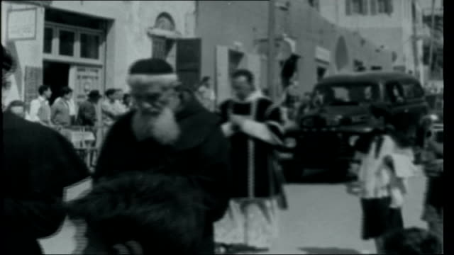 the holy land today franciscan college in nazareth and requiem procession along includes hearse and other funeral cars driving slowly past/ general... - village stock videos & royalty-free footage