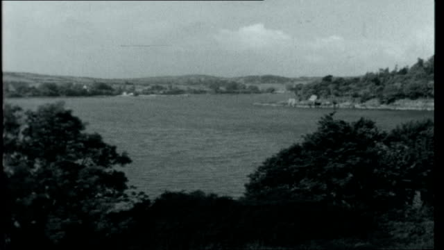 the new irish republic general views of southern ireland hills and coast and countryside / fisherman fishing in lake / more of countryside and coast... - seeufer stock-videos und b-roll-filmmaterial