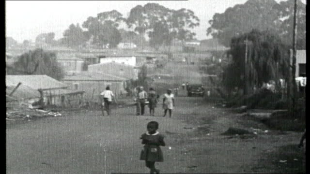 The New Republic ITN Roving Report The New Republic General views of shanty town / Black children on street and people walking around / Sequence...