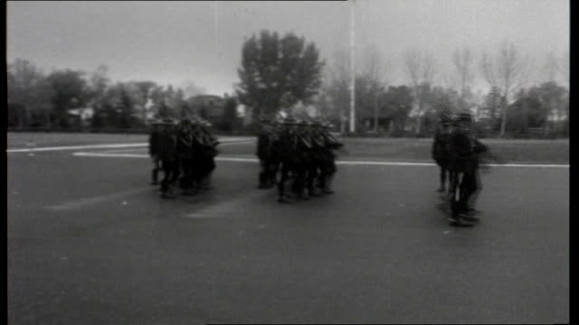 the road to uranium general views of royal canadian mounted police recruits riding past police practising on shooting range including close ups... - uranium stock videos & royalty-free footage