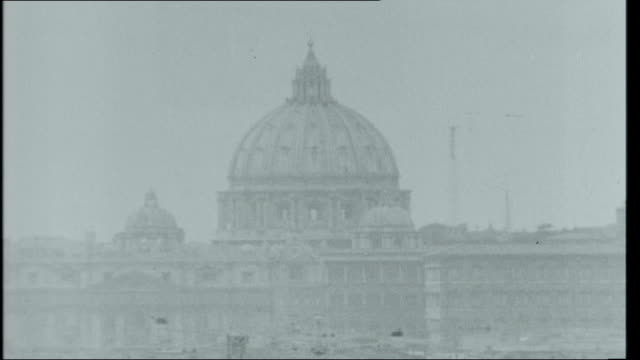 the two worlds of rome dome of st peter's on skyline/ terence mcsweeney amongst crowds of worshipers gathered in st peter's square/ pope paul vi... - st peter's square stock videos & royalty-free footage