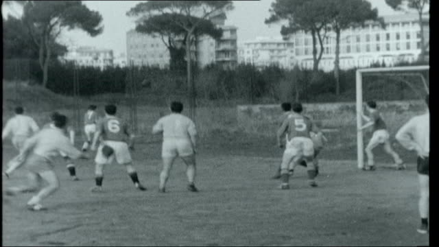 The Two Worlds of Rome Terence McSweeney and other British student priests playing football match against Spanish student team/ General views of St...