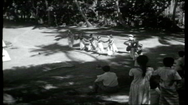 up country in ceylon; temple dancers of kandy performing as dancing and singing to the traditional music sot local people and children watching dance... - golf club stock videos & royalty-free footage