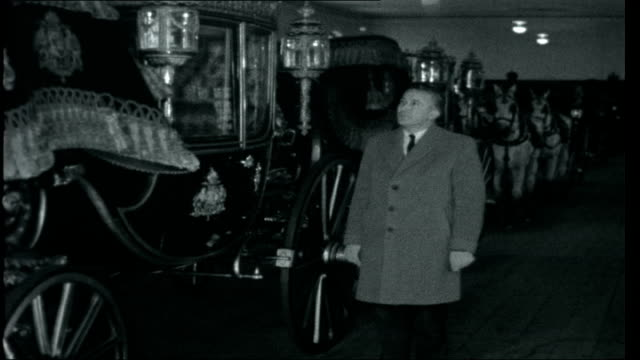 Vienna Capital of Music Reporter in large room with carriages in Imperial Palace of Schoenbrunn/ reporter to camera next to the last of the...