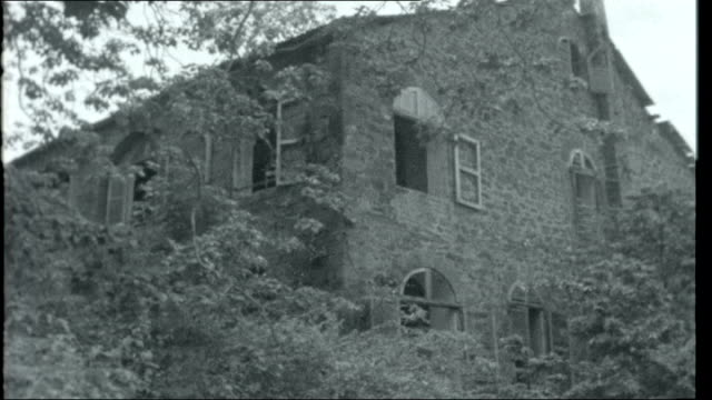virgins and devils; french guiana: devil's island: ruined abandoned old penal colony buildings gradually being taken over by the jungle vegetation... - devil's island french guiana stock videos & royalty-free footage