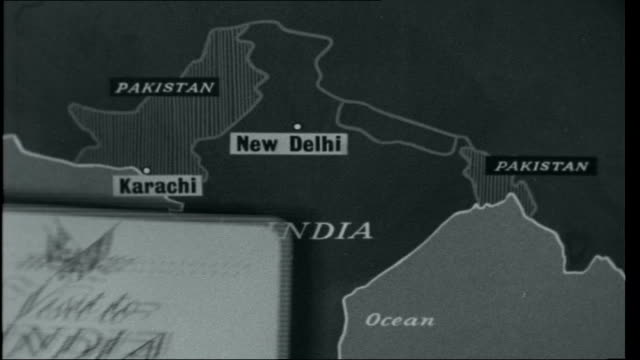Visit to India Map of India showing position of capital New Delhi and also showing Pakistan with capital Karachi hand puts card over map 'Visit to...