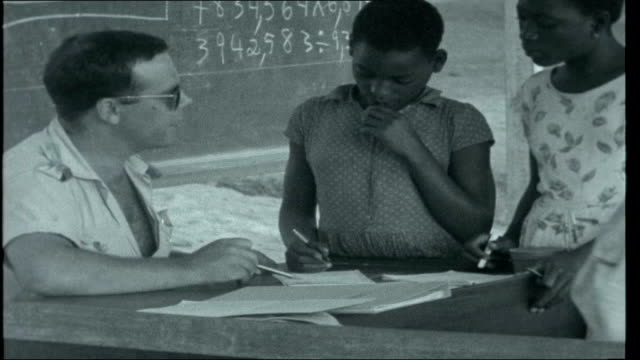 war in angola school children in outdoor lesson teacher in front of blackboard/ portuguese soldiers helping african children with school work/... - portuguese culture stock videos & royalty-free footage