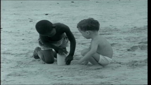 war in angola title sequence war in angola angola luanda ext luanda beach scene children play in the water black and white children play togeher on... - portuguese culture stock videos & royalty-free footage