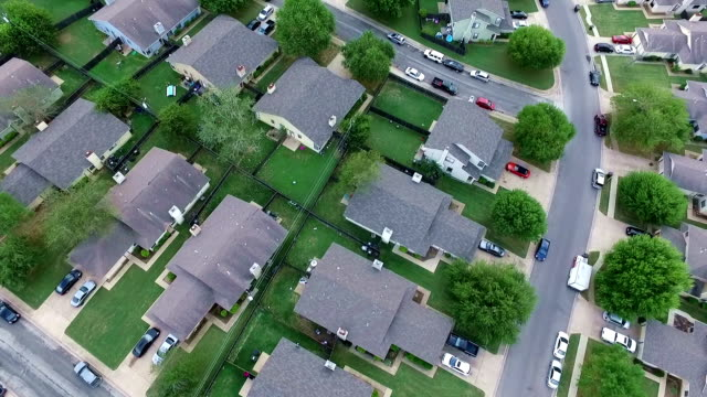 row after row aerial above homes and houses in suburb new modern development in central texas outside of austin, tx - modern rock stock videos & royalty-free footage