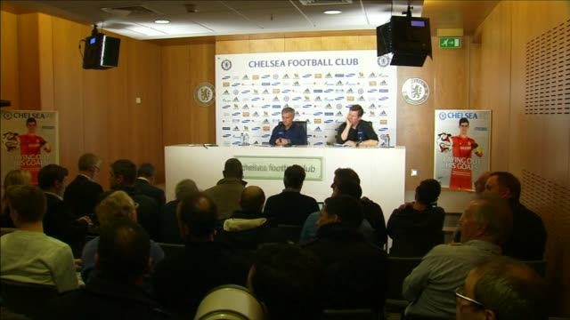 row between jose mourinho and arsene wenger continues surrey cobham wide shot mourinho at press conference chelsea football club crest on wall... - cobham surrey stock videos and b-roll footage