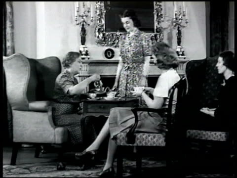 stockvideo's en b-roll-footage met row houses brownstones line city urban street adult women in living room having tea cu stocks bonds in box int brokers at desks in stock exchange... - 1948