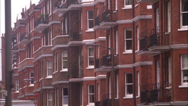 row houses feature balconies. - terraced house stock videos & royalty-free footage