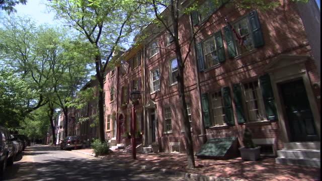row houses line a street in philadelphia, pennsylvania. - row house stock videos & royalty-free footage