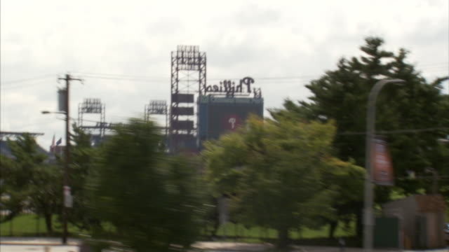 row houses trees citizens bank park empty parking lot phillies baseball sports - philadelphia phillies stock-videos und b-roll-filmmaterial