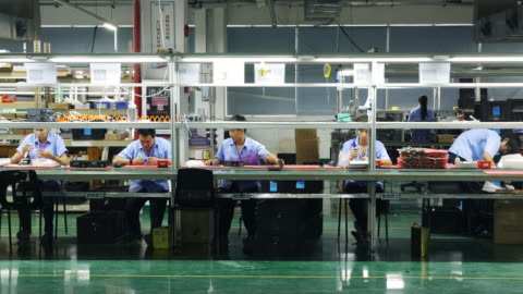 a row of 5 chinese workers assemble circuit boards on an electronics production line in a large private factory - plant stock videos & royalty-free footage