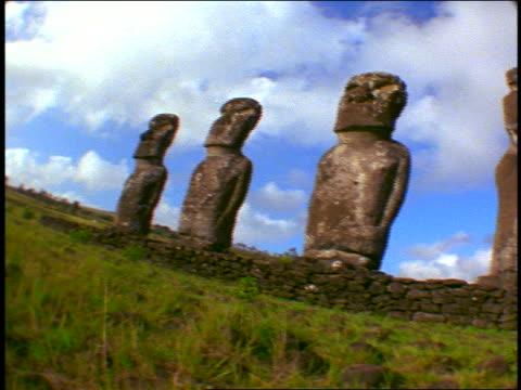fisheye pan row of 7 stone statues on terraced field / easter island - einige gegenstände mittelgroße ansammlung stock-videos und b-roll-filmmaterial