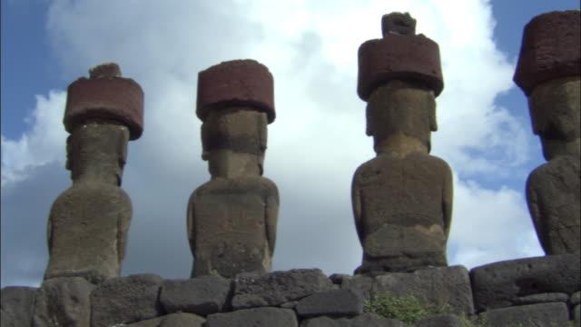 MS LA PAN Row of Ahu Nau Nau statues against sky / Anakena beach, Easter Island, Chile
