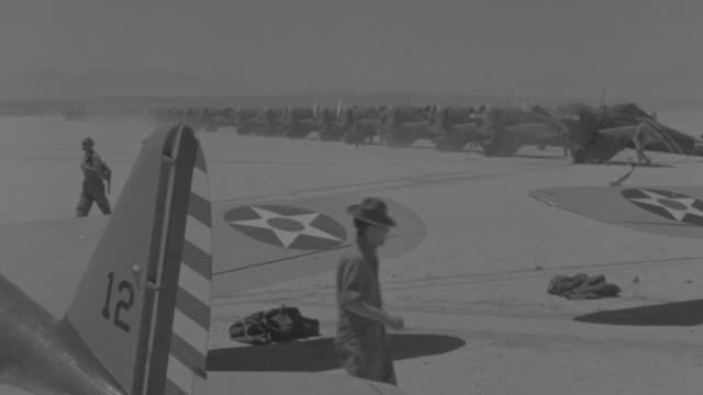 ws row of airplanes on airfield in desert with airplanes - united states airforce stock-videos und b-roll-filmmaterial