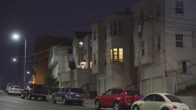 row of apartments in east los angeles - night - stationary点の映像素材/bロール
